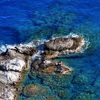 Top view on blue clear sea at sunny day