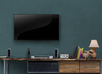 led tv on gray blue wall wooden media furniture