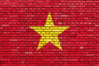 flag of Vietnam painted on brick wall