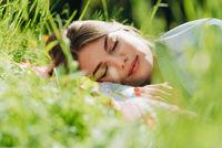 Woman sleeping on grass