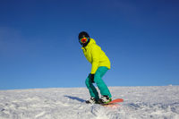 Snowboarder riding on slope