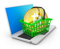 bitcoin in basket on laptop