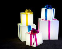 Illuminated christmas gift parcels and boxes in display