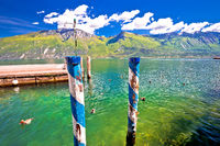 Green lake Garda and alpine mountains view