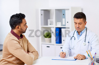 doctor and male patient meeting at hospital