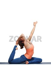 Woman doing Hatha yoga asana Eka pada rajakapotasana