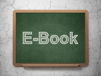 Studying concept: E-Book on chalkboard background