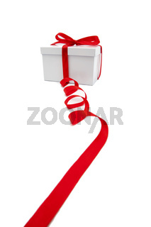 Red ribbon and white gift box