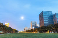 modern buildings with green space in nightfall