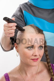 beautiful woman cancer patient shaving hair