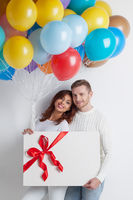 Couple with balloons and gift