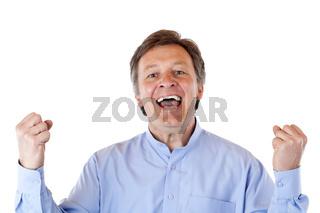 Attraktiver, älterer, erfolgreicher reifer Mann jubelt freudig in Kamera