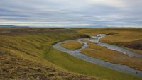 River near Skagastroend, north Iceland. Green meadow.