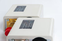 Close-up Two new identical pressure switches in the pipeline for monitoring and balancing the pipeline pressure with mechanical displays.