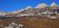 Walenstadt Dorf and mountains of the Churfirsten range. Multi colored autumn forest. Beautiful landscape in Switzerland.