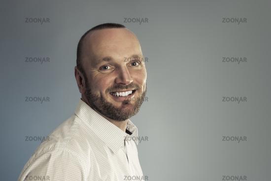 bearded smiling man portrait