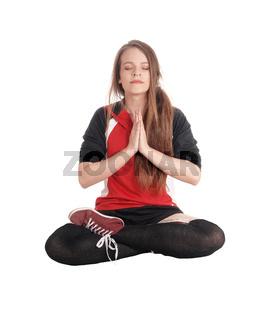 Beautiful woman sitting in joga pose