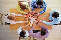 People grabbing pizza