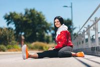 City workout. Beautiful young woman training in an urban setting
