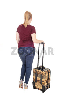 Woman standing from back with suitcase