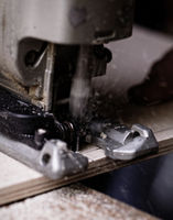 Photo of a man working with fret saw