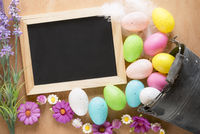 Bucket with Easter eggs and a chalkboard