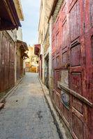 Old street with red door in Fes medina