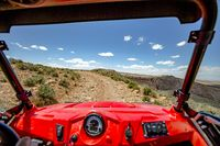 View from the inside of the off road vehicle White Rim Road Utah trails straight ahead on a sunny day