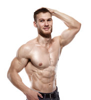 Portrait of a muscular male model isolated on white