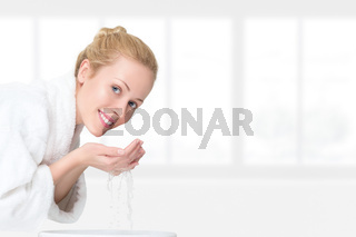Young woman washing her face