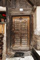 Old wooden door in D'ultimo