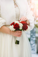 Bouquet of roses in the hands of the bride