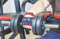 Man doing exercise with dumbbell for forearms