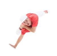 Teenager dancing break dance in action