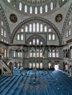 Interior of Nuruosmaniye Mosque, an Ottoman Baroque style mosque, with a huge dome  many colored stained glass windows located in Shemberlitash, Fatih, Istanbul, Turkey