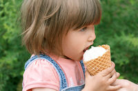 Cute girl are eating icecream