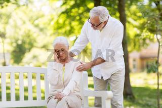 senior woman suffering from headache outdoors