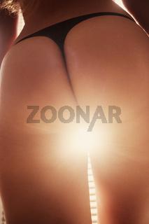 female buttocks in sunlight