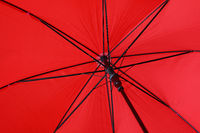 Close up red umbrella low angle view