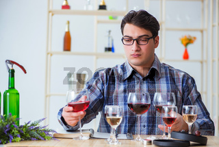 Professional sommelier tasting red wine