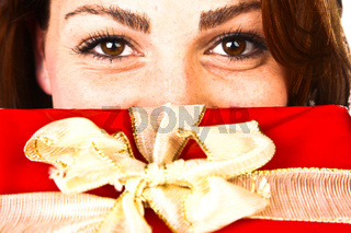 Closeup Photo Of A Woman With A Red Nice Christmas Gift