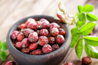 Dog rose or rosehip berries with leaves, dried briar