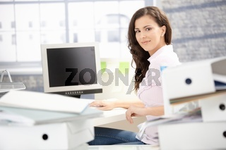 Attractive girl working in bright office smiling