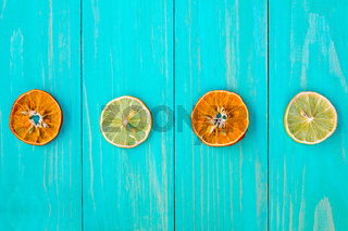 Four dry slices of orange and lemon