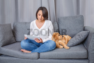 Portrait of young woman with her dog