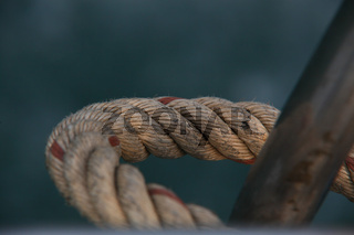 Detail Closeup Of A Bent Rigid Ship Rope