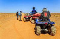 Ait Saoun, Morocco - February 23, 2016: Tourist on ATV in Ait Saoun Desert of Morocco wearing helmet for safety precautionary measure.