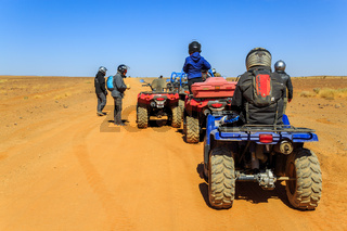 Ait Saoun, Morocco - February 23, 2016: Tourist on ATV in Ait Saoun Desert of Morocco wearing helmet for safety precautionary measure.