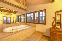 Bright, open and bathroom with vaulted ceilings and a wonderful bath tub