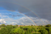 Beautiful double rainbow over summer city